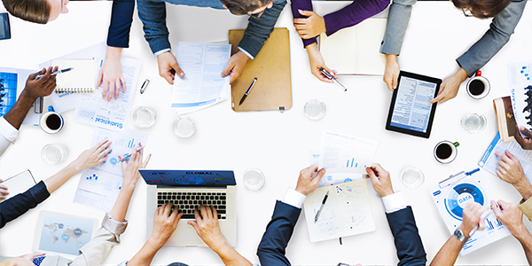 People Working Around Conference Table