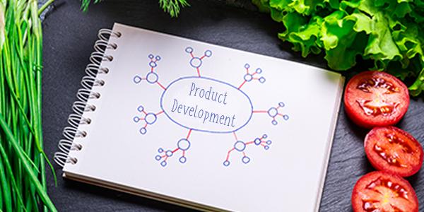 Product Development Written on Notepad